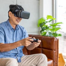 Senior man playing virtual reality game